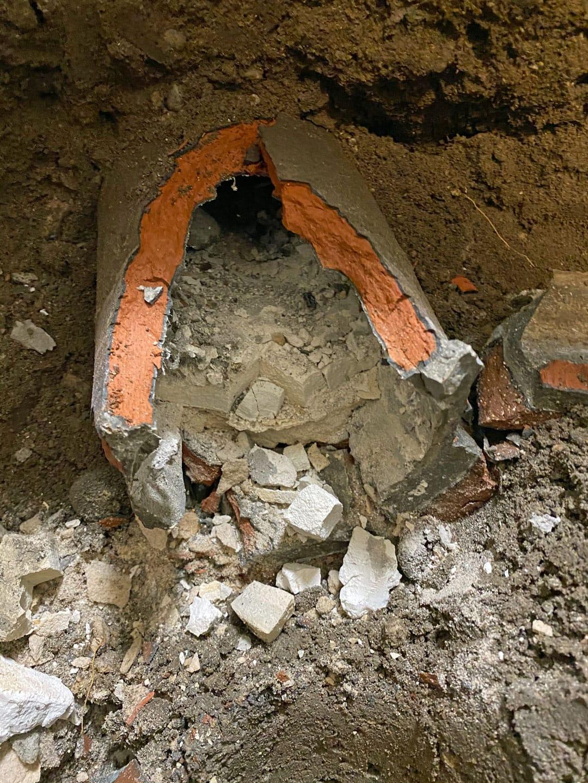 broken weeping tile in the ground under the basement floor